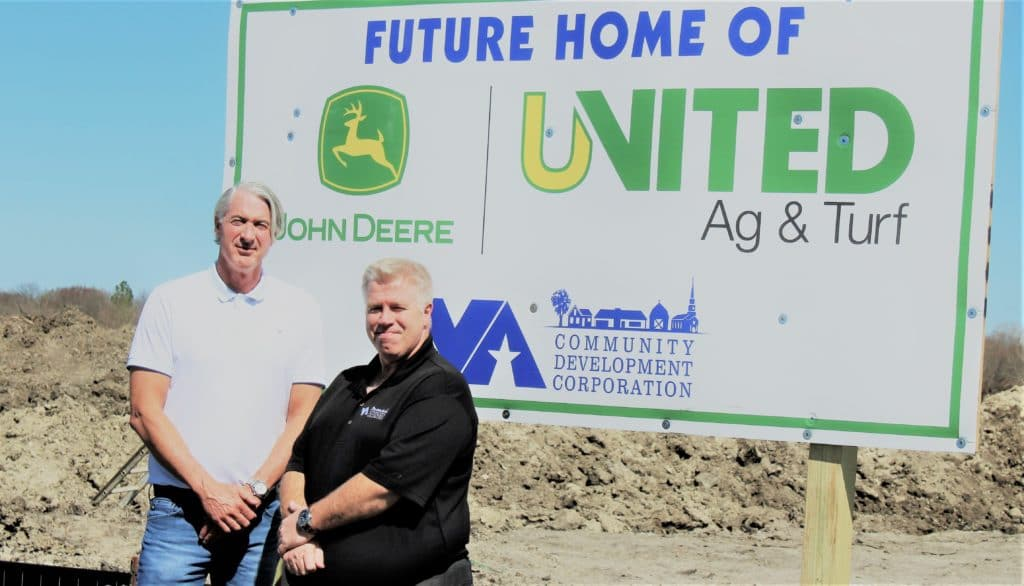 Sign for new John Deere building under construction in Van Alstyne.