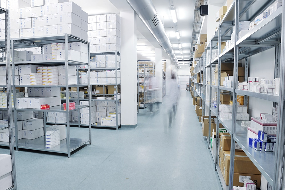 Inside of a warehouse with shelving and products